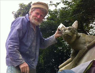 Photo of Tom Clark repairing a wolfs ears