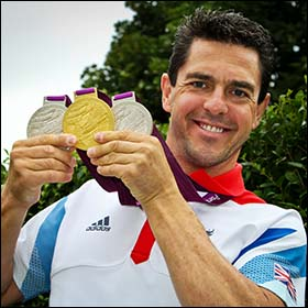 Photo of Mark Colbourne with 2012 Paralympic medals