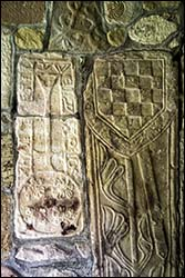 Photo of tomb slabs in Gyffin church porch