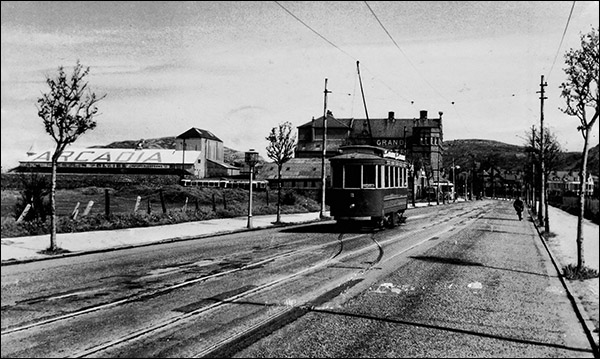 Old photo of tramway in Mostyn Broadway