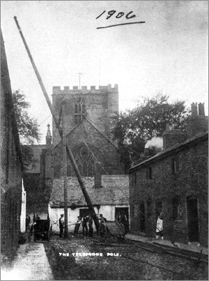 Old photo showing the erection of a telephone pole