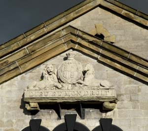 photo of royal coat of arms on court house